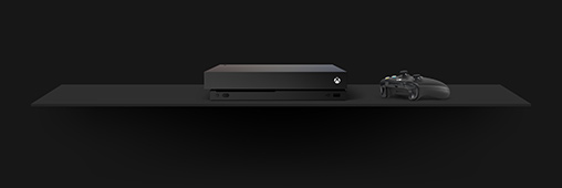 an xbox one x console and controller